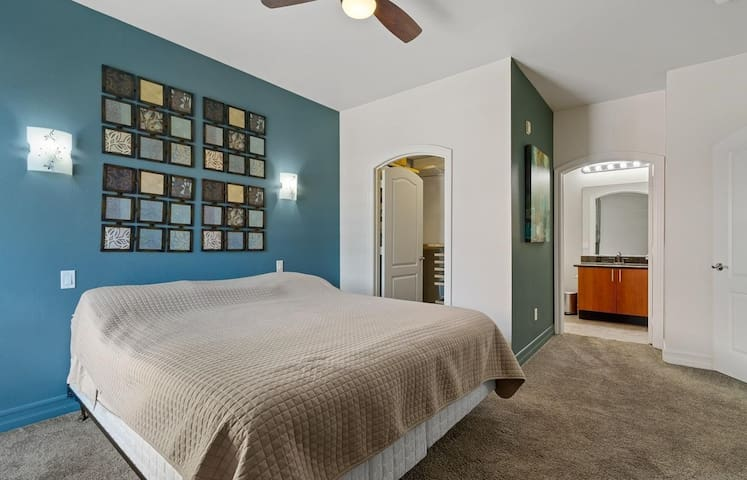 Master bedroom with Cal King bed and walk in closet and private bathroom.