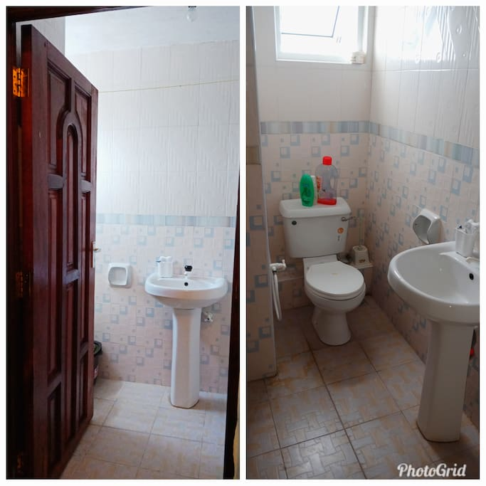 Clean and spacious toilet space  with shower gel and toiletries.