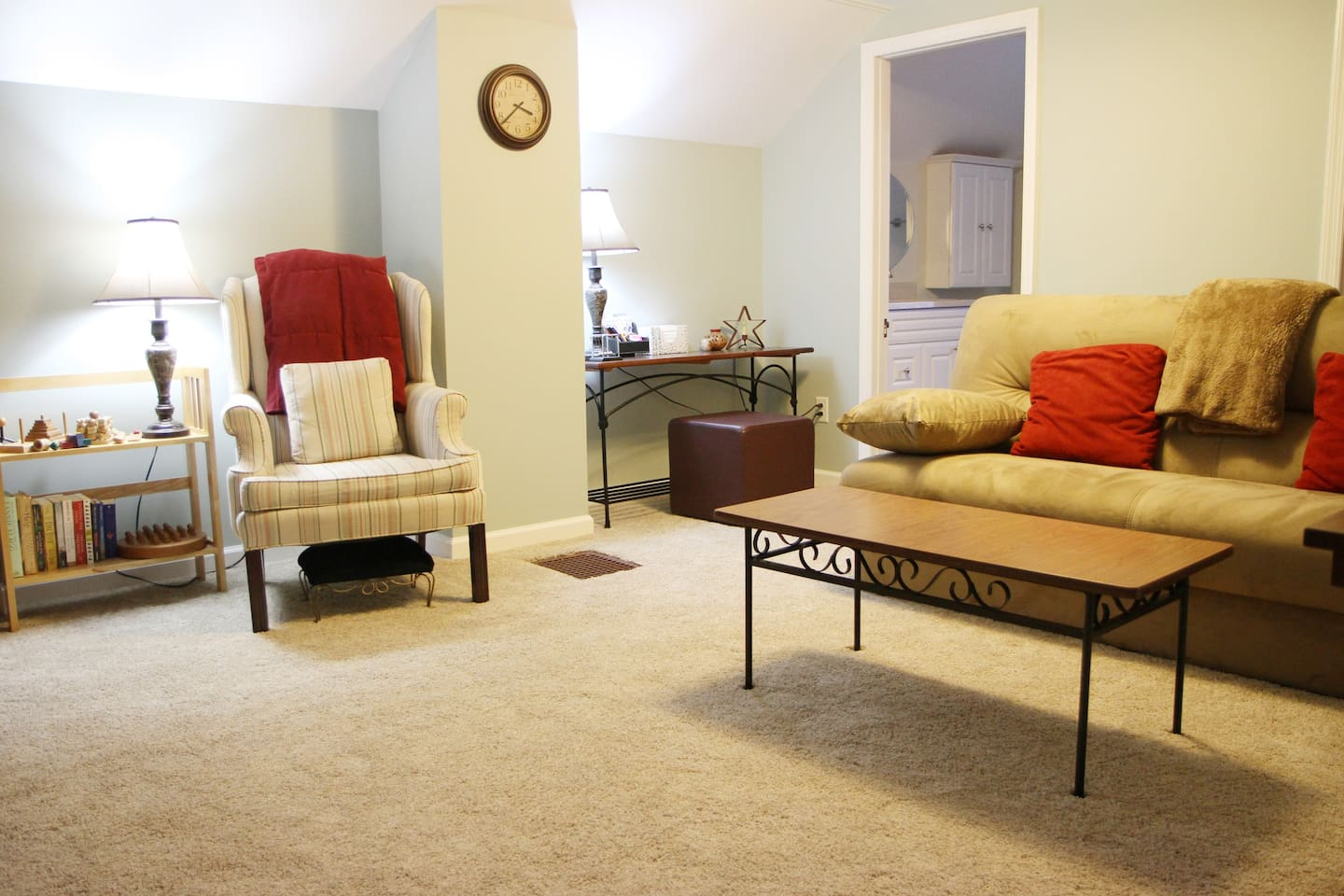 Sitting room with comfortable chair and sofa that opens to a full size bed. Cable TV included.