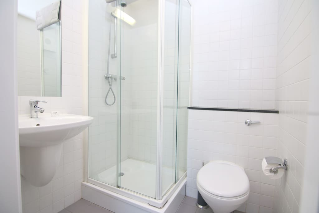 En suite bathroom with immersion heated shower.