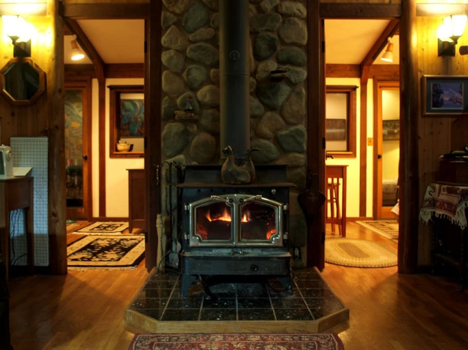 The cozy wood stove in between the two guest bedrooms.