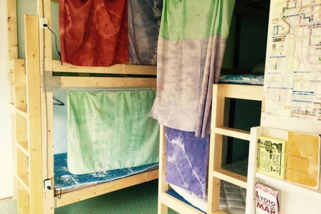 3 bunk beds in 1 room, with sofa bed & table.