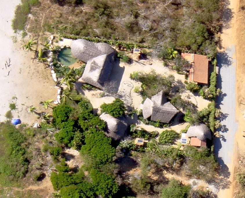 Areal view of property, beach is to left, road to the right, Casa Viva in between