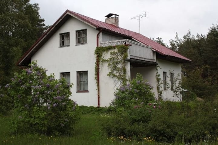 Countryhouse with natural pool and garden .