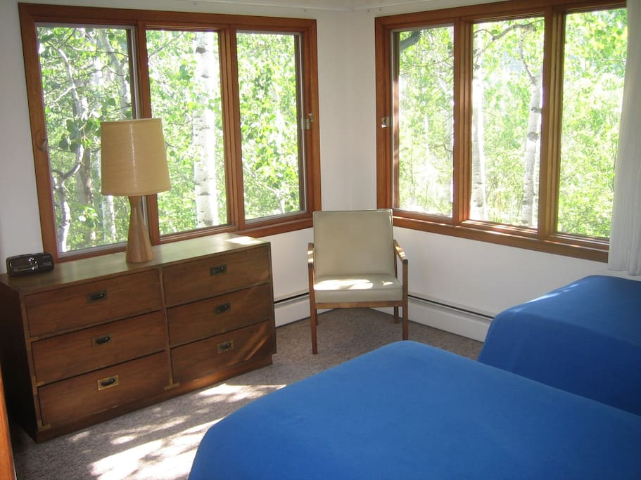 One of three bedrooms surrounded by Aspen trees.
