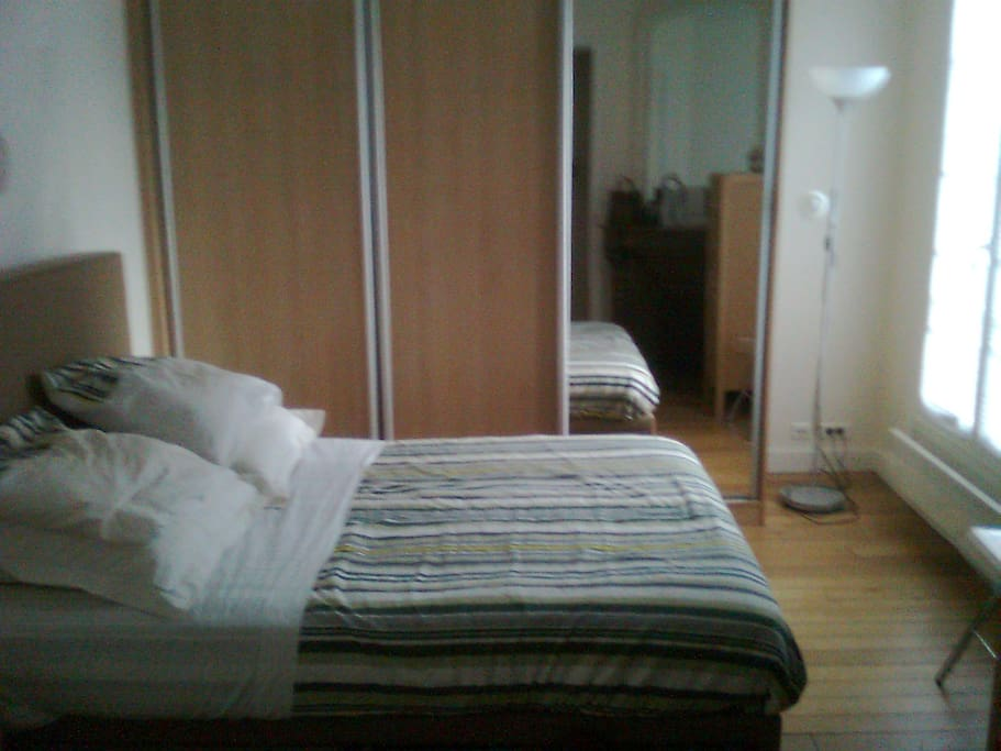 Bedroom: large wardrobe equipped as dressing