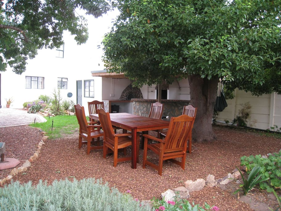 Outside entertainment area with teak wood  seats for 6,  pizza oven and BBQ