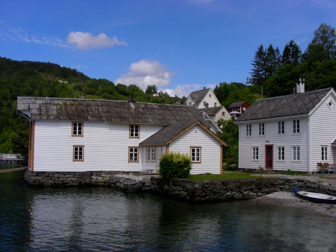 The old trading place by the fjord. The beach house to the right.