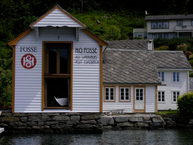 Sea house and the old post office in front of the beach house