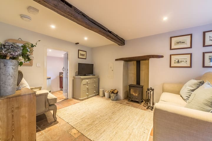 Ground floor:  Sitting room with beamed ceiling and wood burning stove