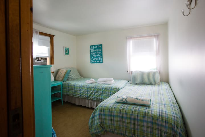 Beachy bright bedroom with 2 twins, nightstand & dresser
