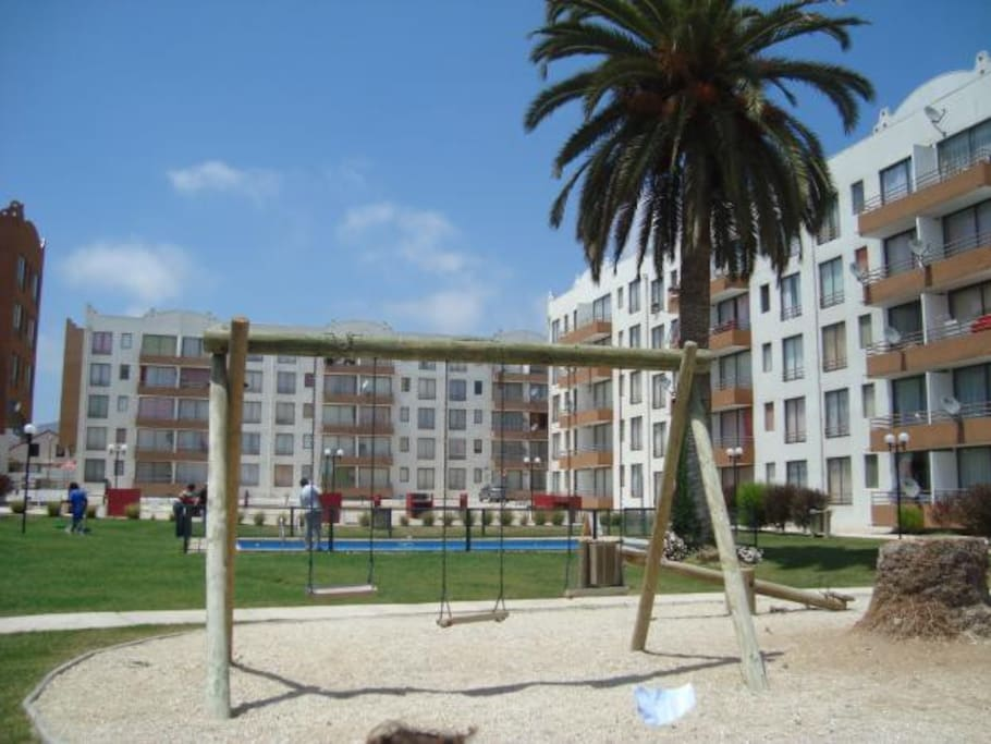 One of the 4 pools and many BBQ areas within the complex, along with playgrounds for the children or the young at heart.