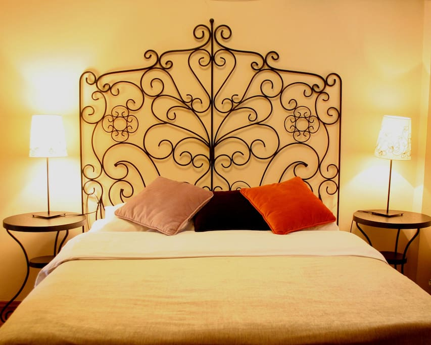 Double bed at the entrance with lights on