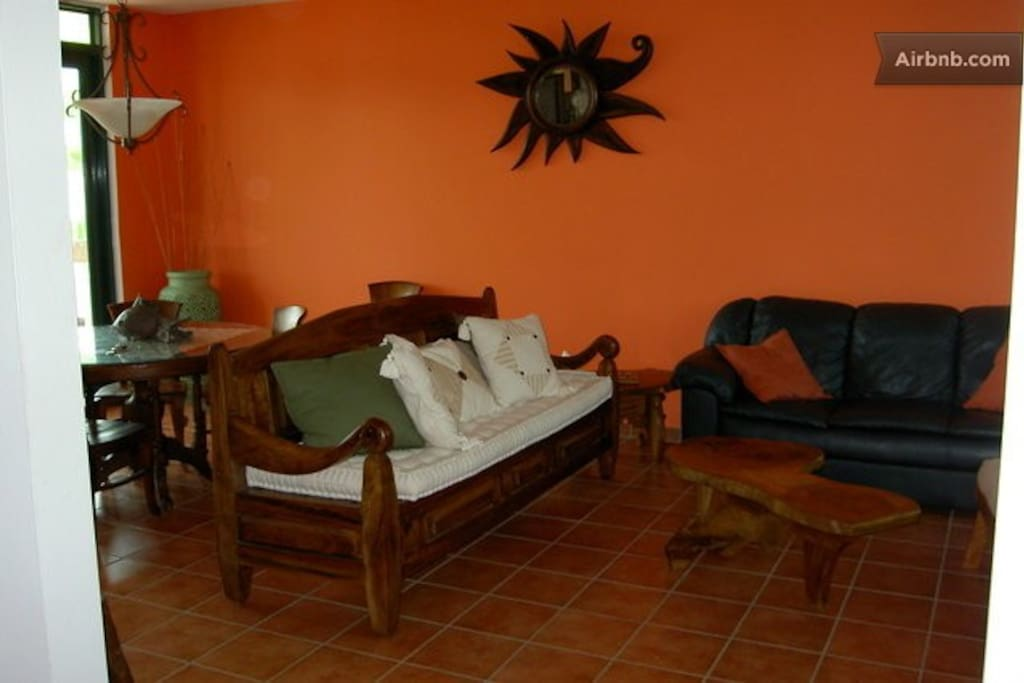 Another view of living room and dining area