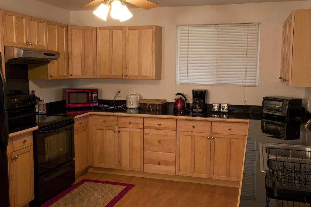 Large kitchen fully stocked with kitchen utensils, pots & pans, dishes, and more! Coffee, tea, and breakfast ingredients are included in the room rate.