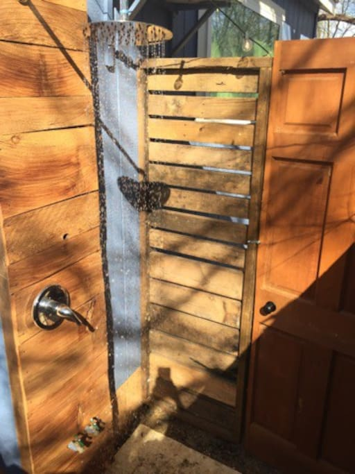 Outdoor shower with hot and cold water.