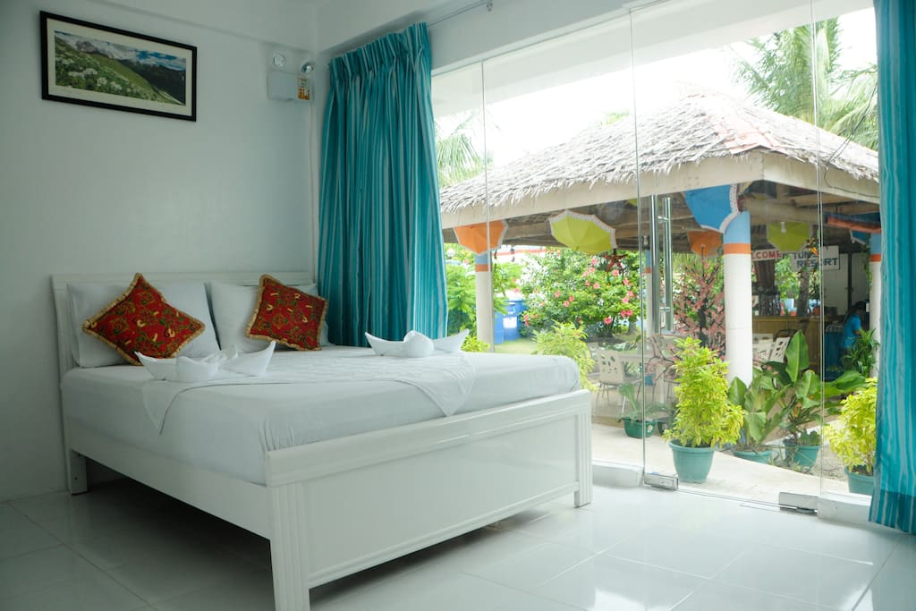 Ground Suite queen bed with cottage hall with mini store