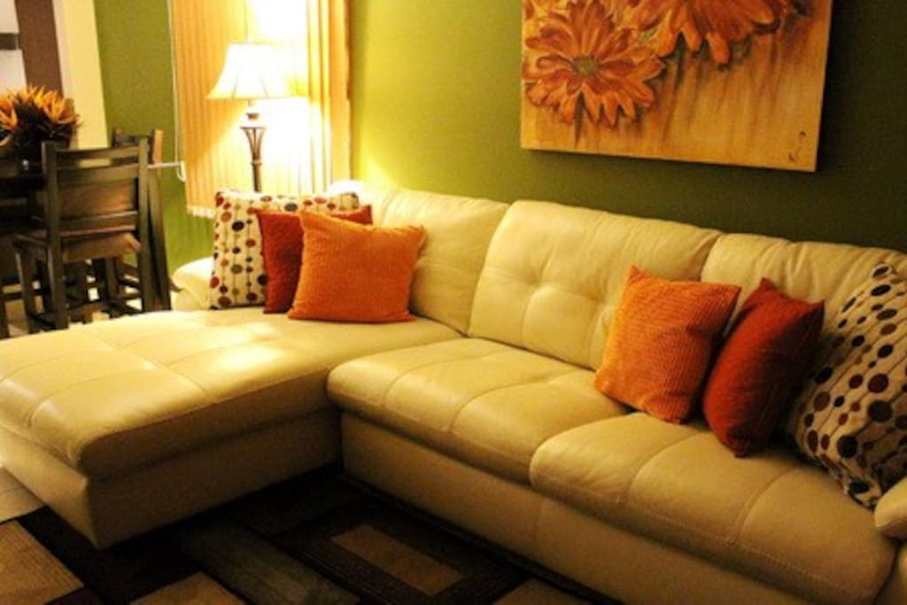 An inviting leather couch. Great to curl up on for fun bluray movies and satellite TV programs.