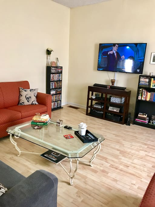 "60"" tv with access to Netflix, HULU & we also have a load of dvds that can be played in the Blue Ray player. Feel free to grab a book if you'd like."