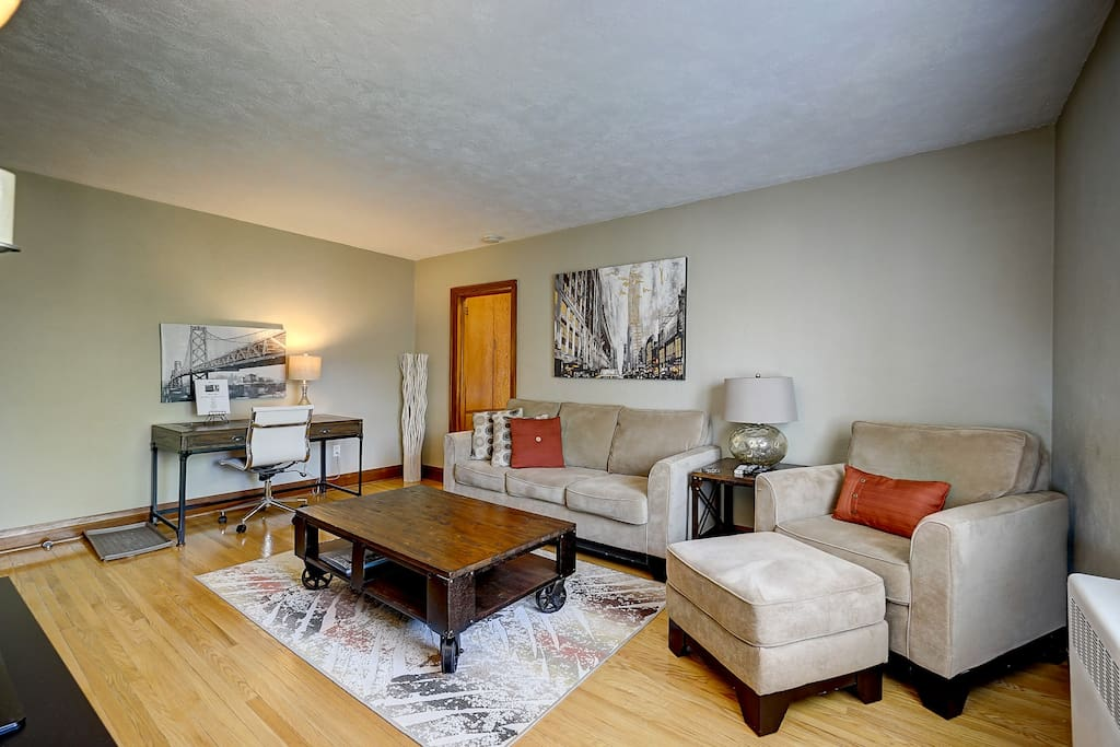 Large bright living room with desk