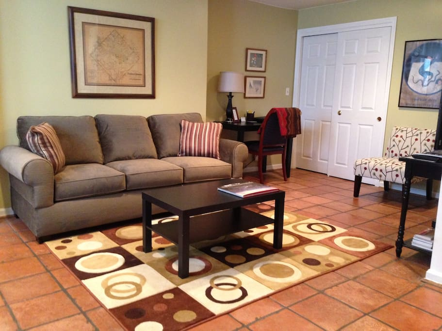 Living room includes queen size sofa bed, desk, and high speed wireless internet access.