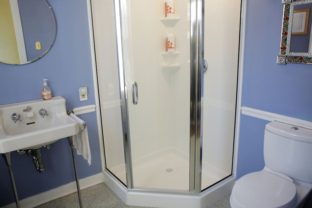 Bathroom is just down the hallway (plush robe provided for your convenience).