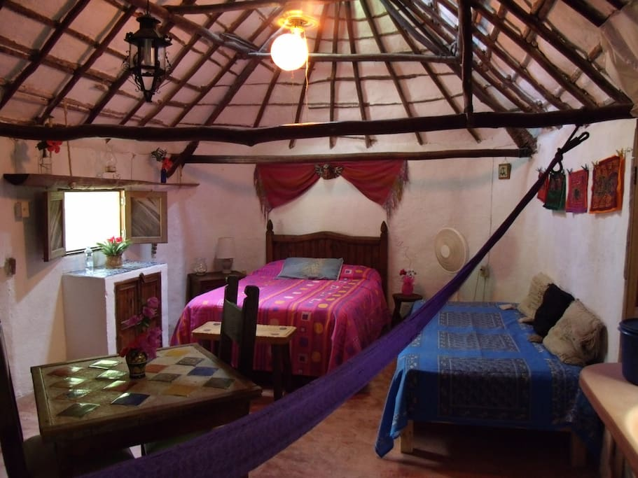 Casitas Kinsol Guesthouse in Puerto Morelos - near Cancun - Room #1 - An authentic Mayan hut with a stucco roof on the original wood beams -