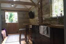 Kitchenette with fridge and breakfast bar