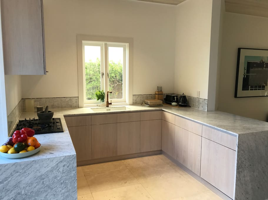 Just renovated: Carrara Marble and lime stone finished kitchen
