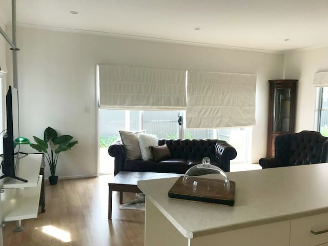 Spacious and comfortable living area with HD Television, NBN wifi, Airconditioning and Chesterfield lounge chairs.