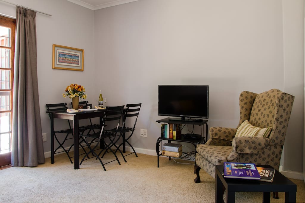 Sitting room with dining / working table and Satellite TV.    Free Wifi.