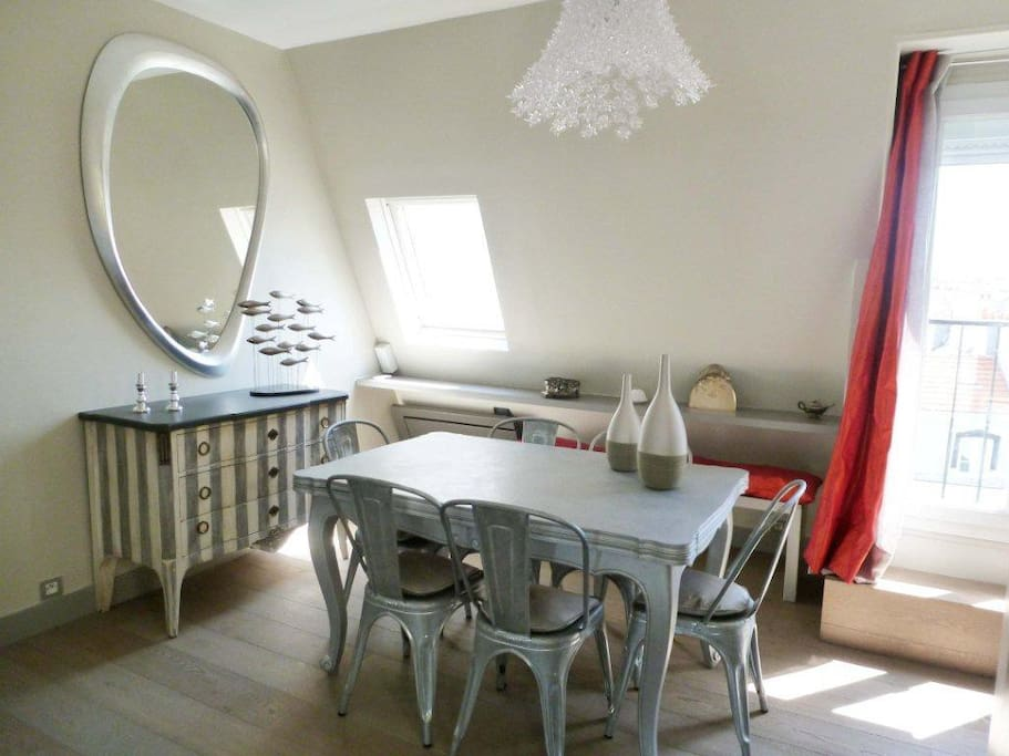Dining room with the french window that leads to a tiny balcony