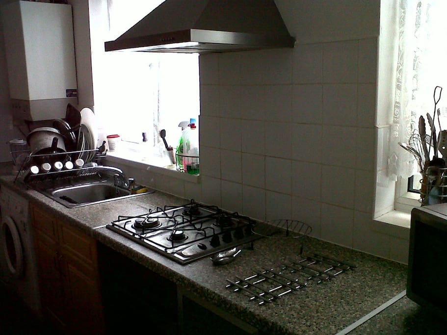 Kitchen with microwave, kettle, toaster,  sandwich maker, shared fridge.