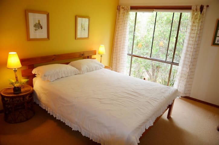 The Banksia Room - upstairs double bedroom with queen-sized bed and ensuite