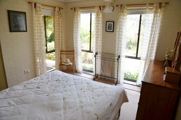 The Garden Room - wake up to the birds in the downstairs queensized double room.