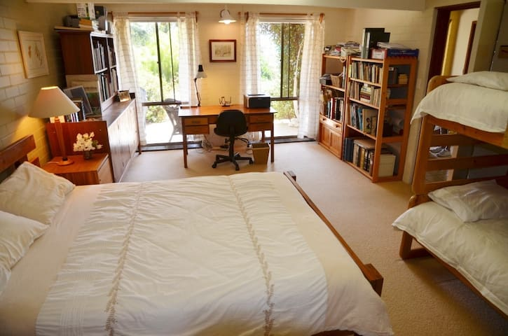 The Family Room - downstairs with a queen-sized double and bunk beds