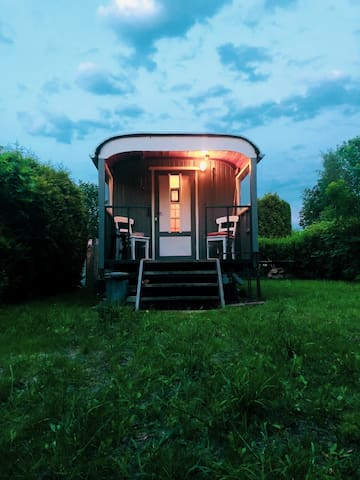 Beautiful old house on wheels by a lake!