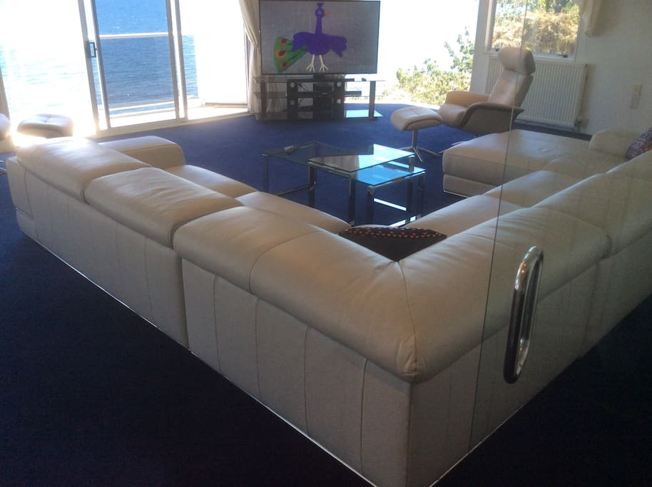 The comfortable leather lounge suite upstairs is a place to congregate and relax.
