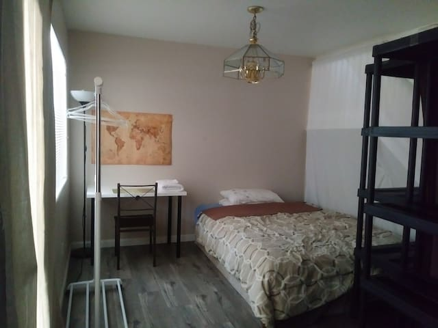 Converted room with queen size bed.   B