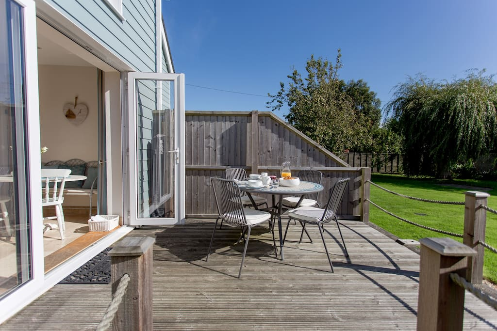 Private decking area with south facing views over the mature garden complete with birds and resident red squirrels who visits the lawn frequently.
