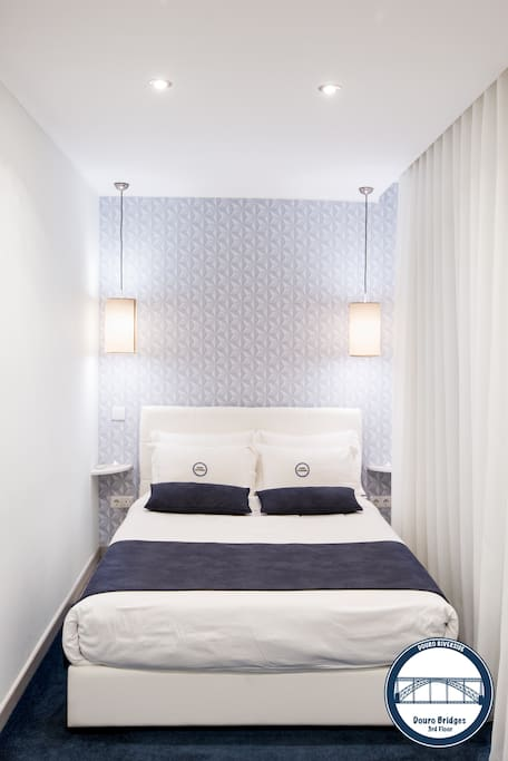 Bedroom with a double size bed and comfy bed linens