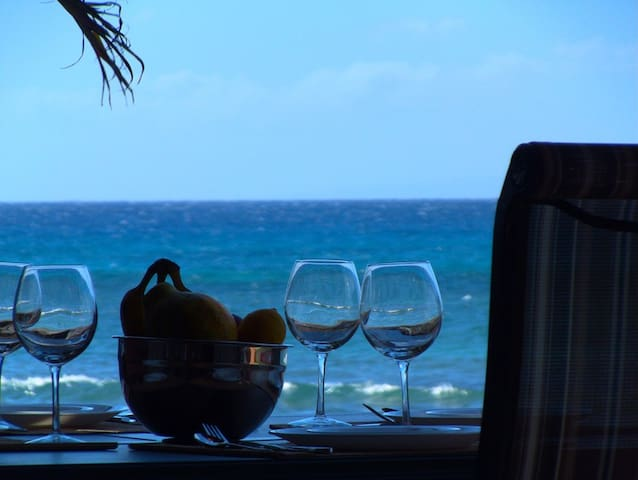 Enjoy oceanfront dining from your private lanai!