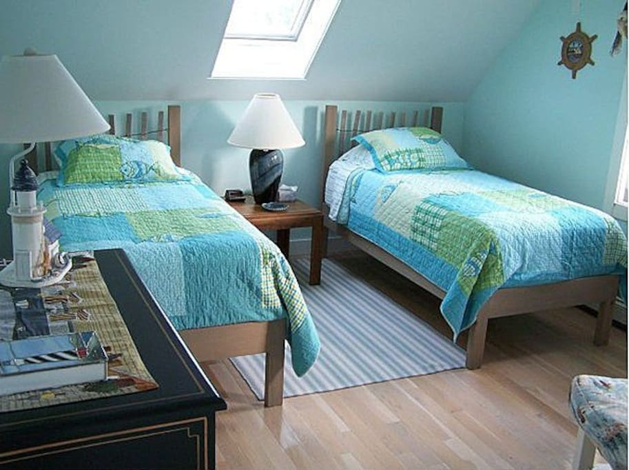 Twin Bedroom with 2 twin beds and a twin futon.