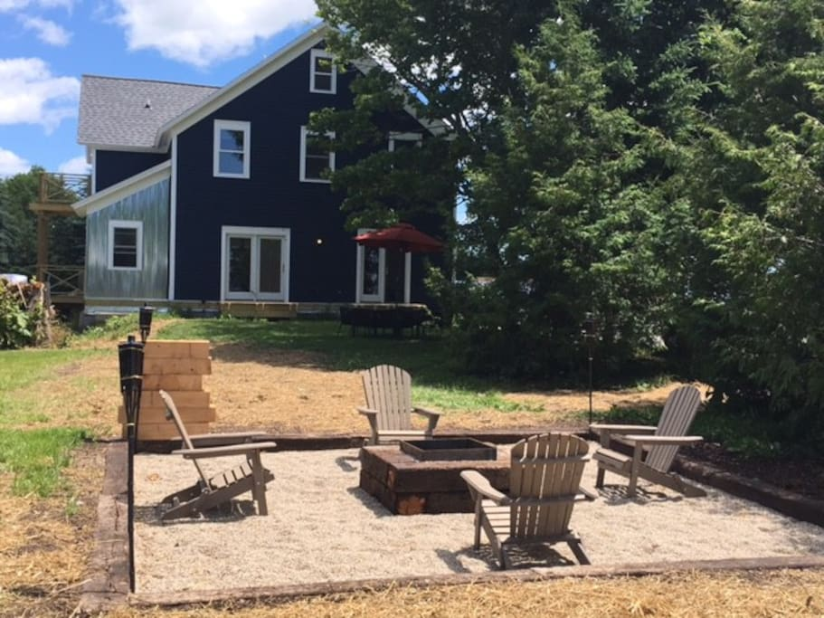 Rear of Farmhouse w/ Firepit+Chairs+Tikki Torches+ Dining Table