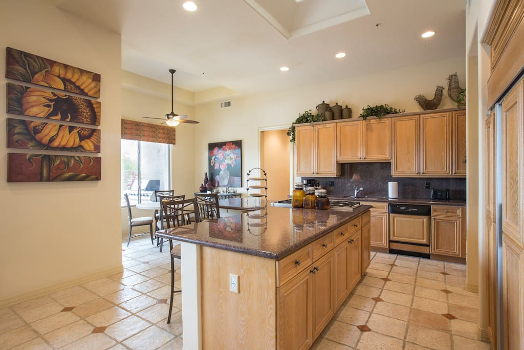 Kitchen with bar seating and dinner table overlooking the mountains and golf course