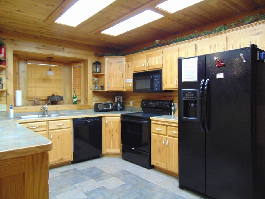 Kitchen with refrigerator, stove/oven, microwave, and dishwasher