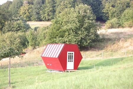 Api house - sleeping on bee hives