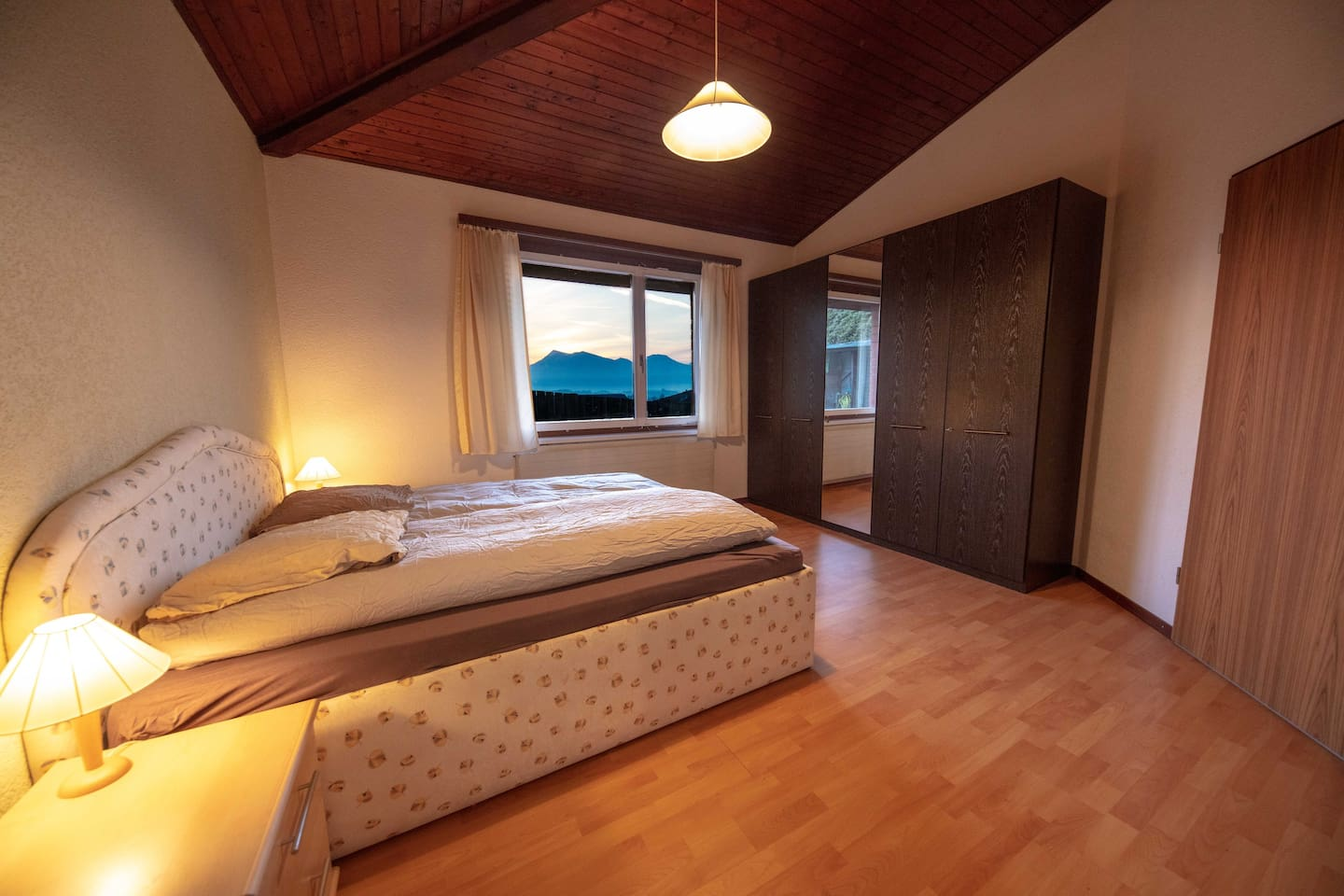 your room with a stunning view on the lake and the mountains .