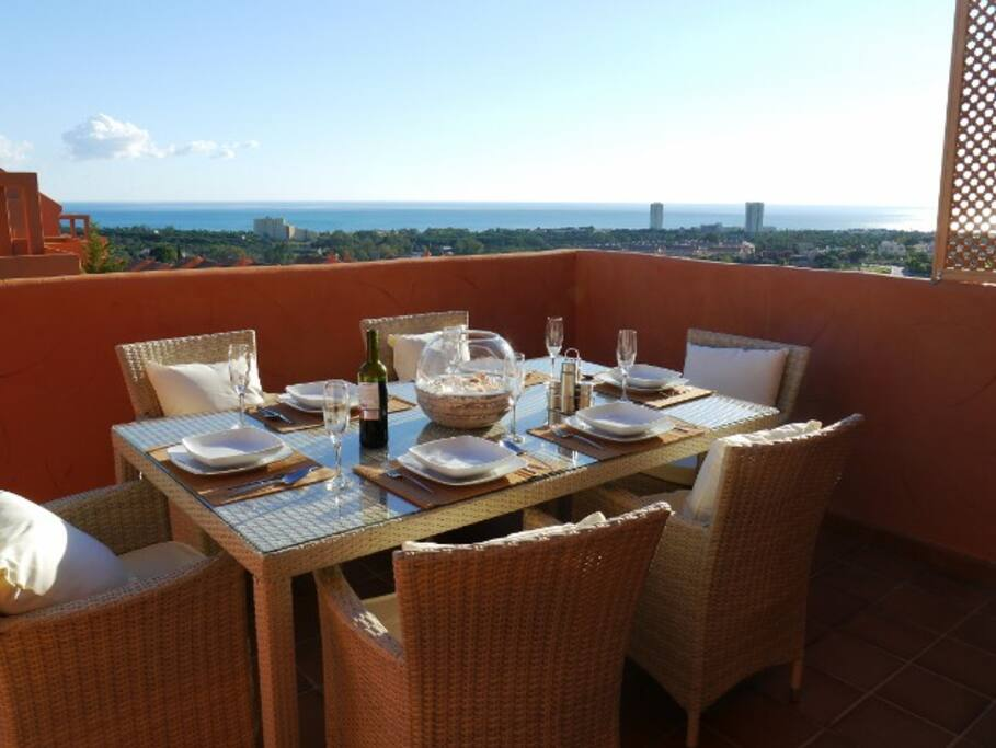 Dining on the terrace with sea views