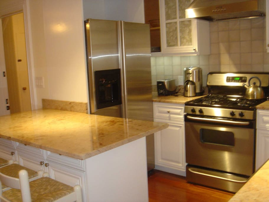 Stainless steel appliances and an eat at granite counter make for a comfortable kitchen.
